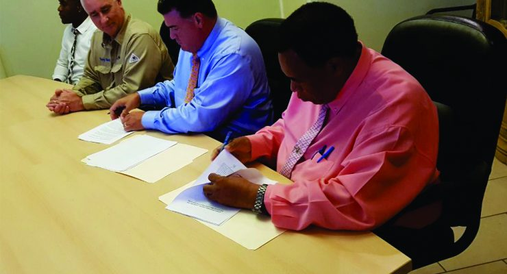 Governor Woodley signs Nustar agreement