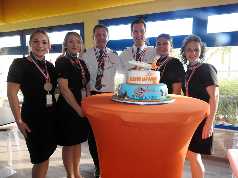 Sunwing crew posing at inaugural flight