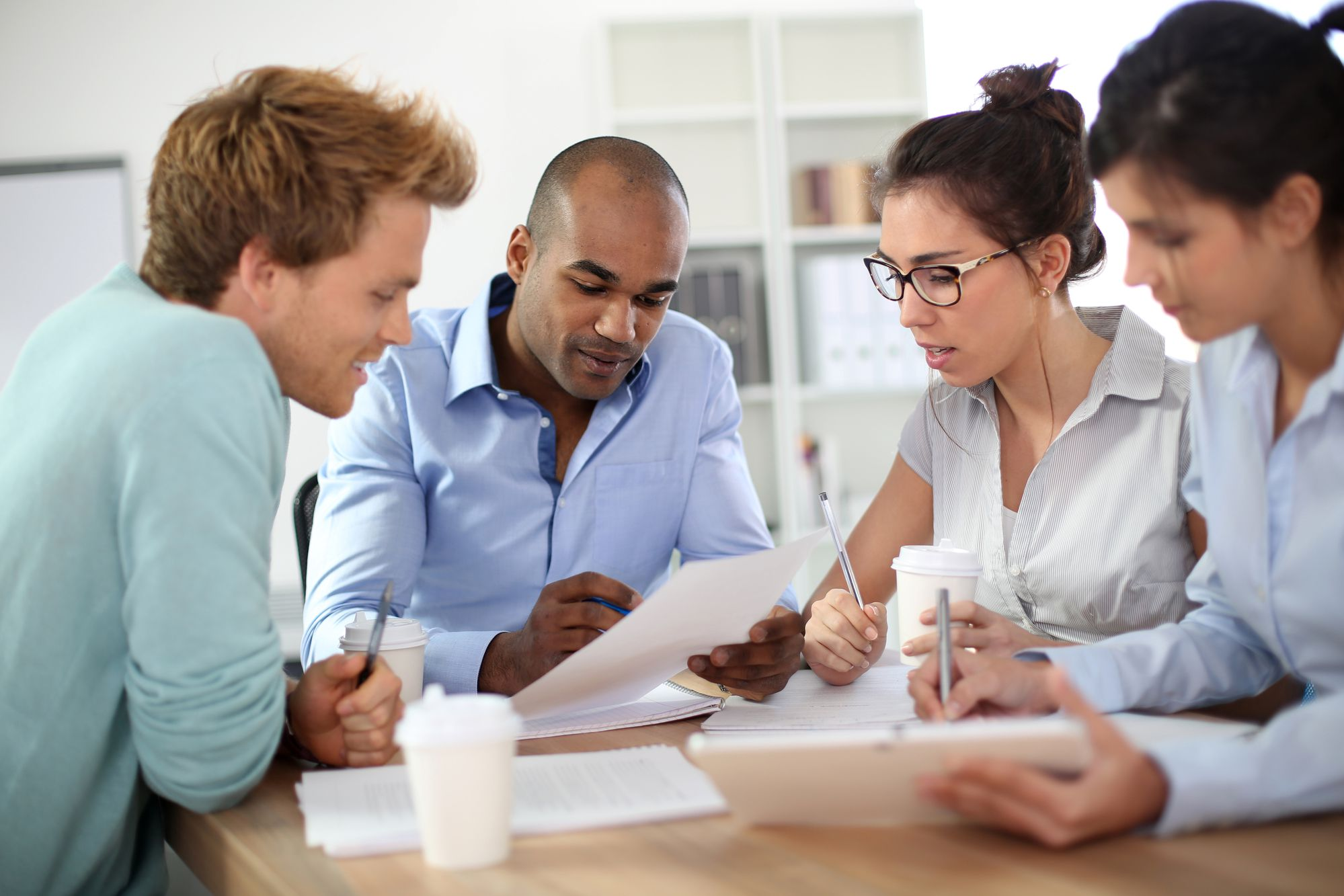 Young business people meeting around table