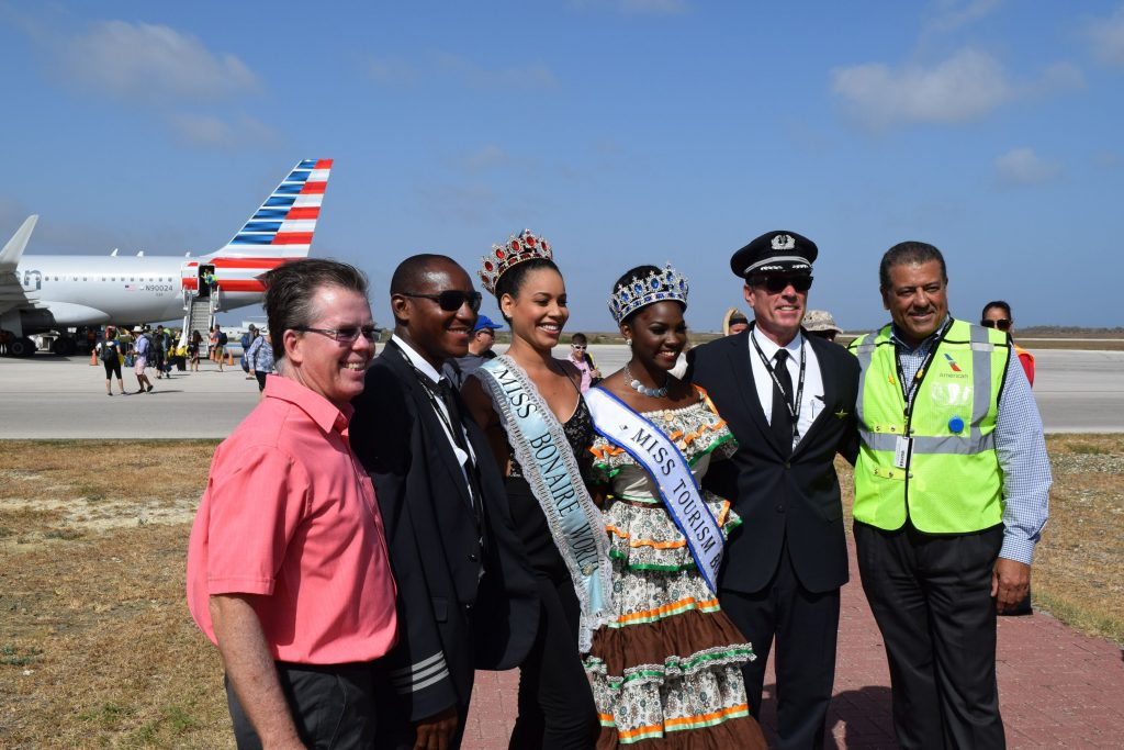 Flight crew posing at arrival of First American Airlines flight Photo HL